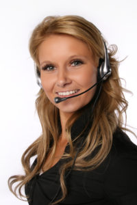 Beautiful blond business woman with headset. Call Center Operator. Over white background in studio.